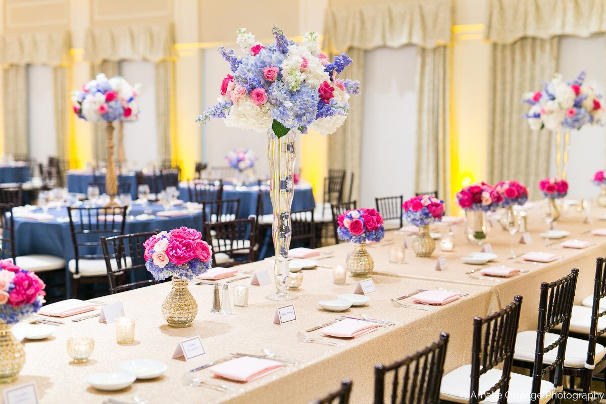 wedding reception table decor at Interlachen Country Club with amber uplighting