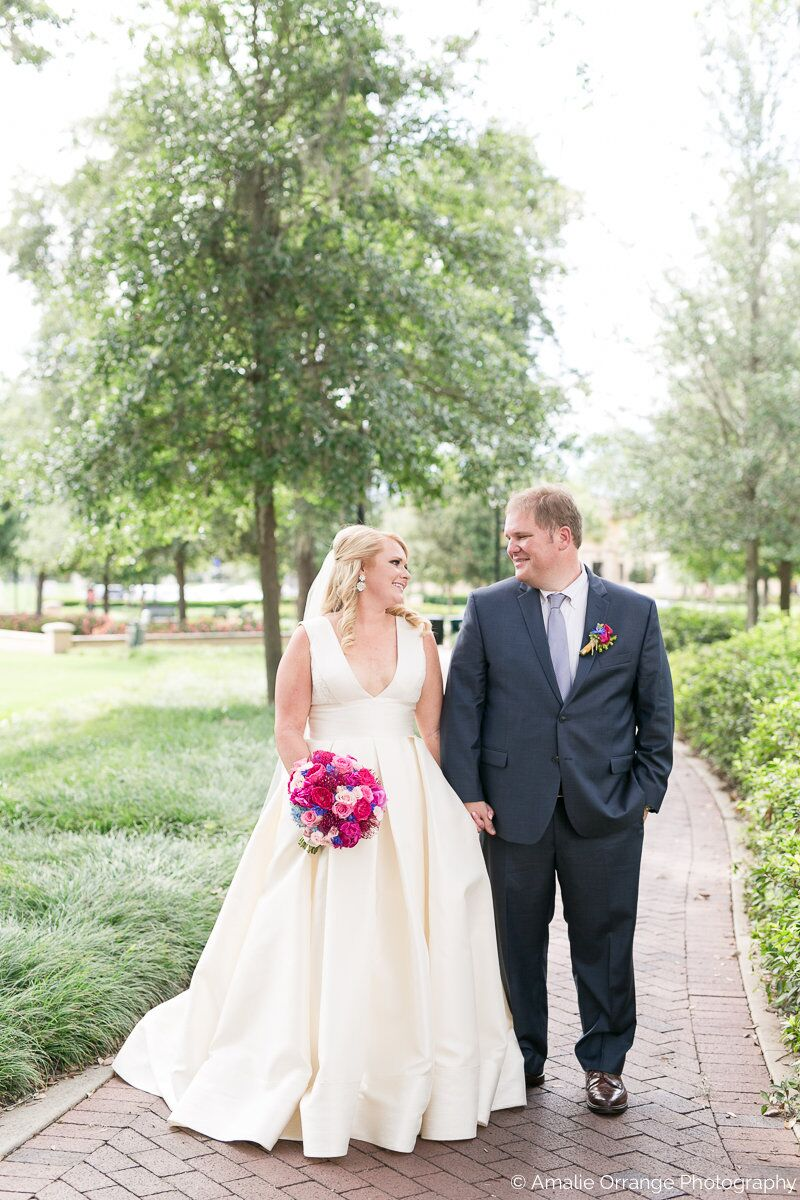 wedding at Interlachen Country Club with amber uplighting bride and groom