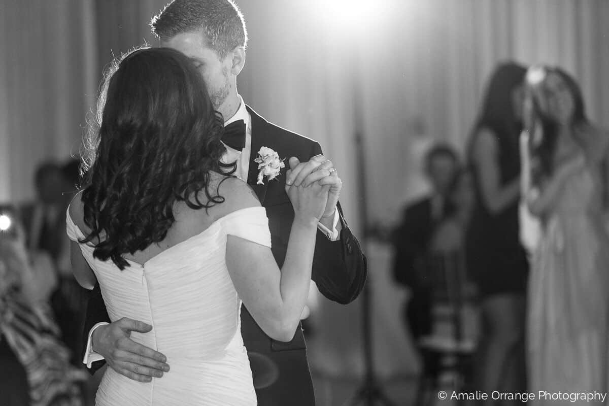 wedding couple first dance with white uplighting at alfond inn
