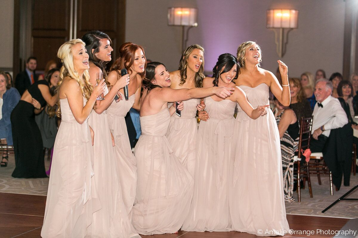 wedding bridesmaids dancing with white uplighting at alfond inn