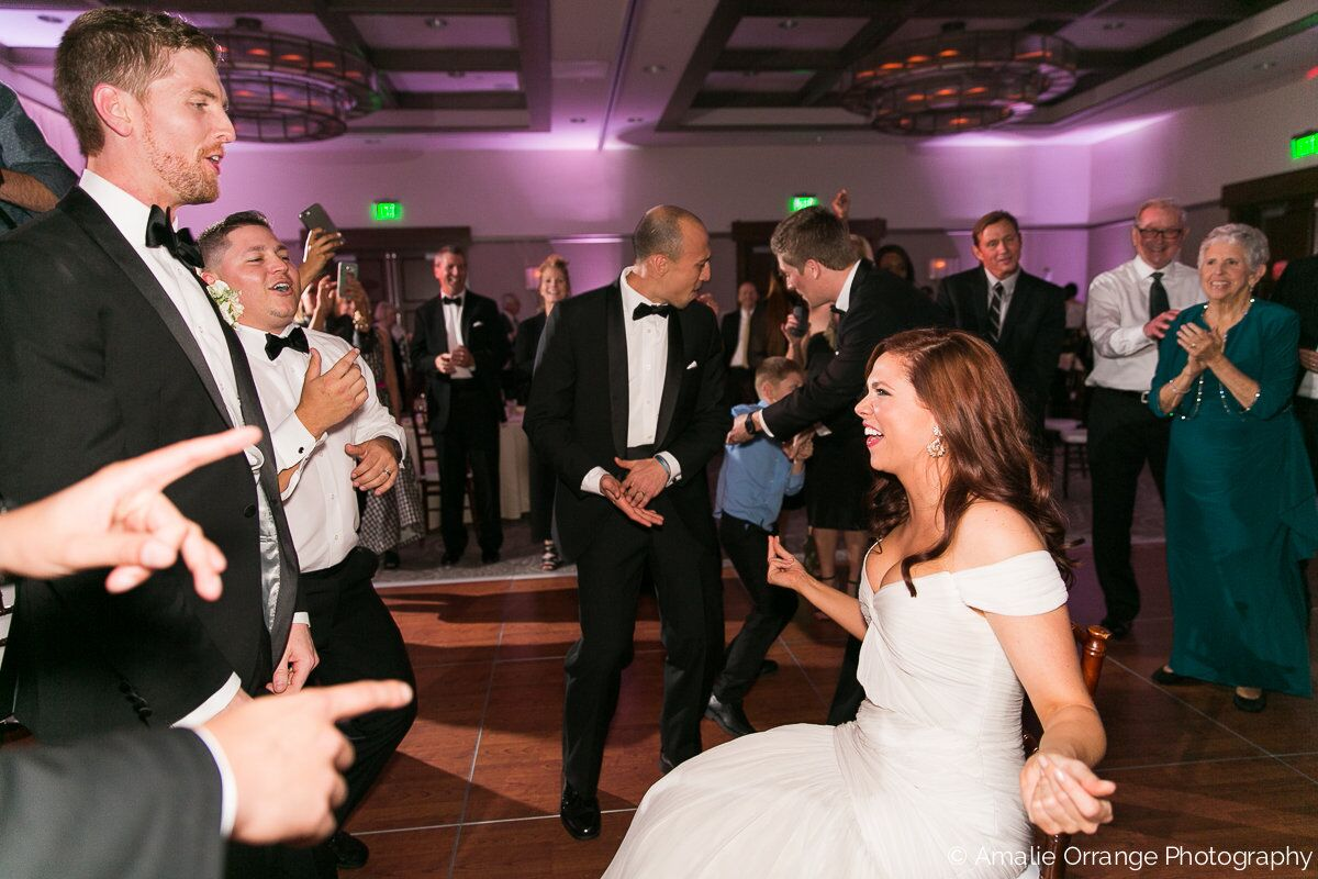 wedding bride and groom dancing with white uplighting at alfond inn