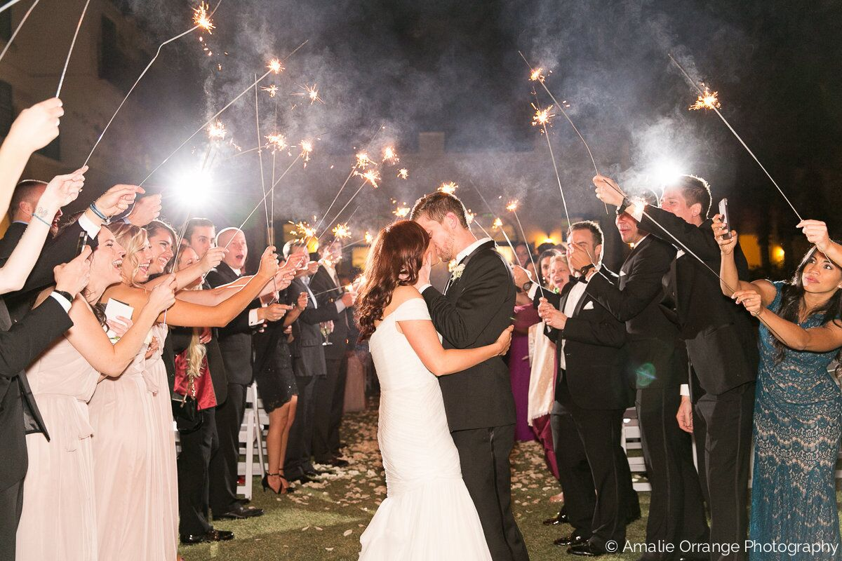 wedding grand sparkler exit with white uplighting at alfond inn