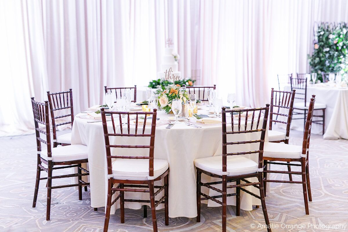 wedding table decor with white uplighting at alfond inn