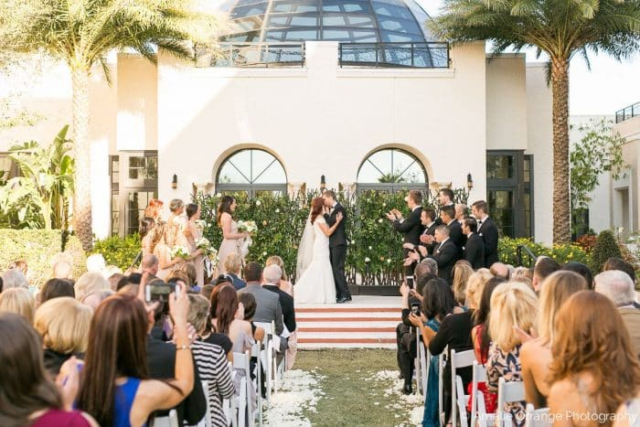 wedding ceremony with white uplighting at alfond inn