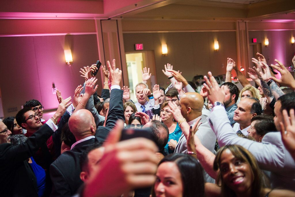 wedding guests dance at  leu gardens wedding with pink uplighting and dj in orlando