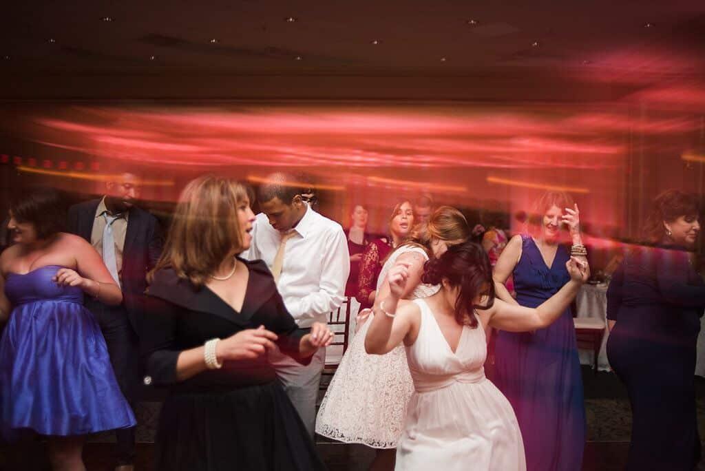 dancing at leu gardens wedding with pink uplighting and dj in orlando