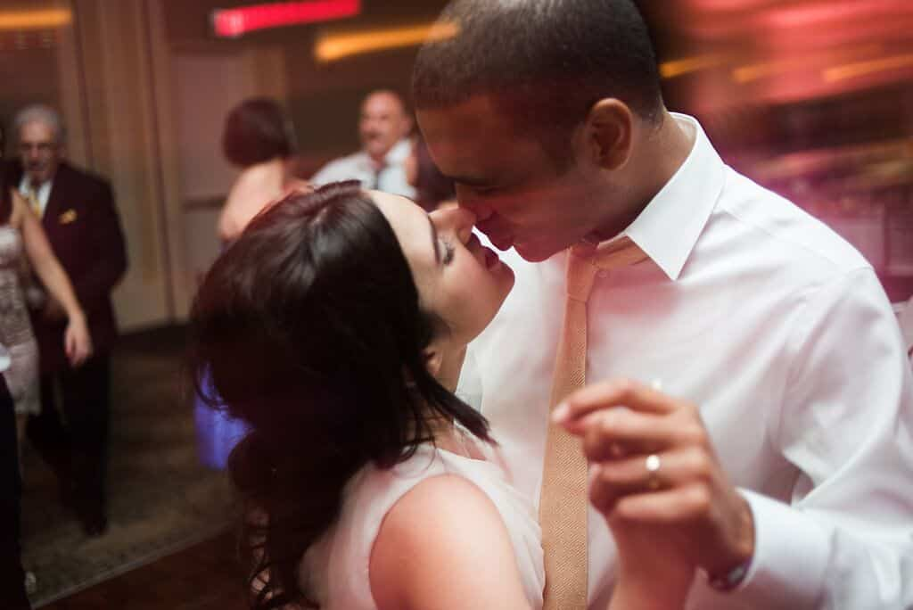 bride and groom kiss at leu gardens wedding with pink uplighting and dj in orlando