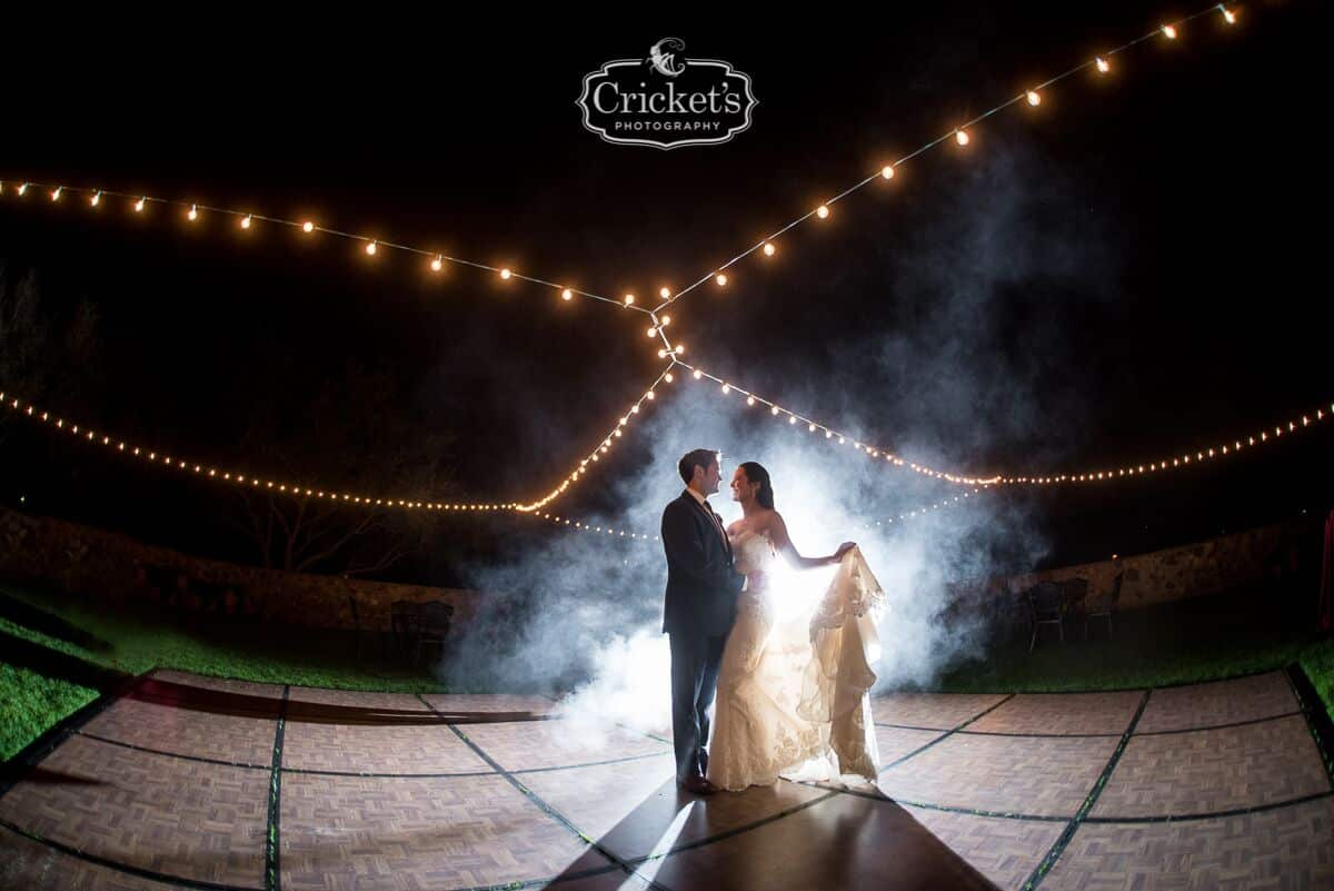 vendors who rock Crickets photography bride and groom dancing with fog