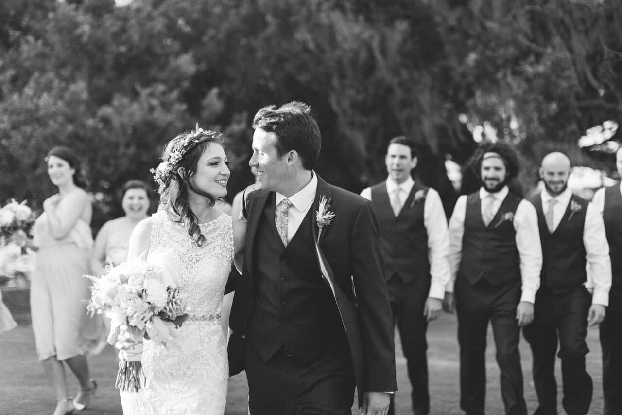 mission inn wedding with amber uplighting bride, groom, and wedding party pictures