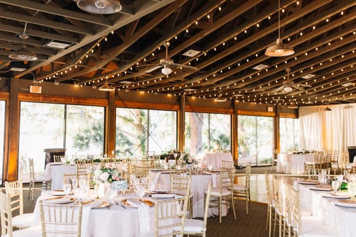 mission inn wedding with amber uplighting reception set up