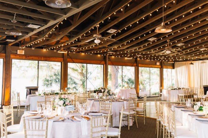 mission inn wedding with amber uplighting reception set up