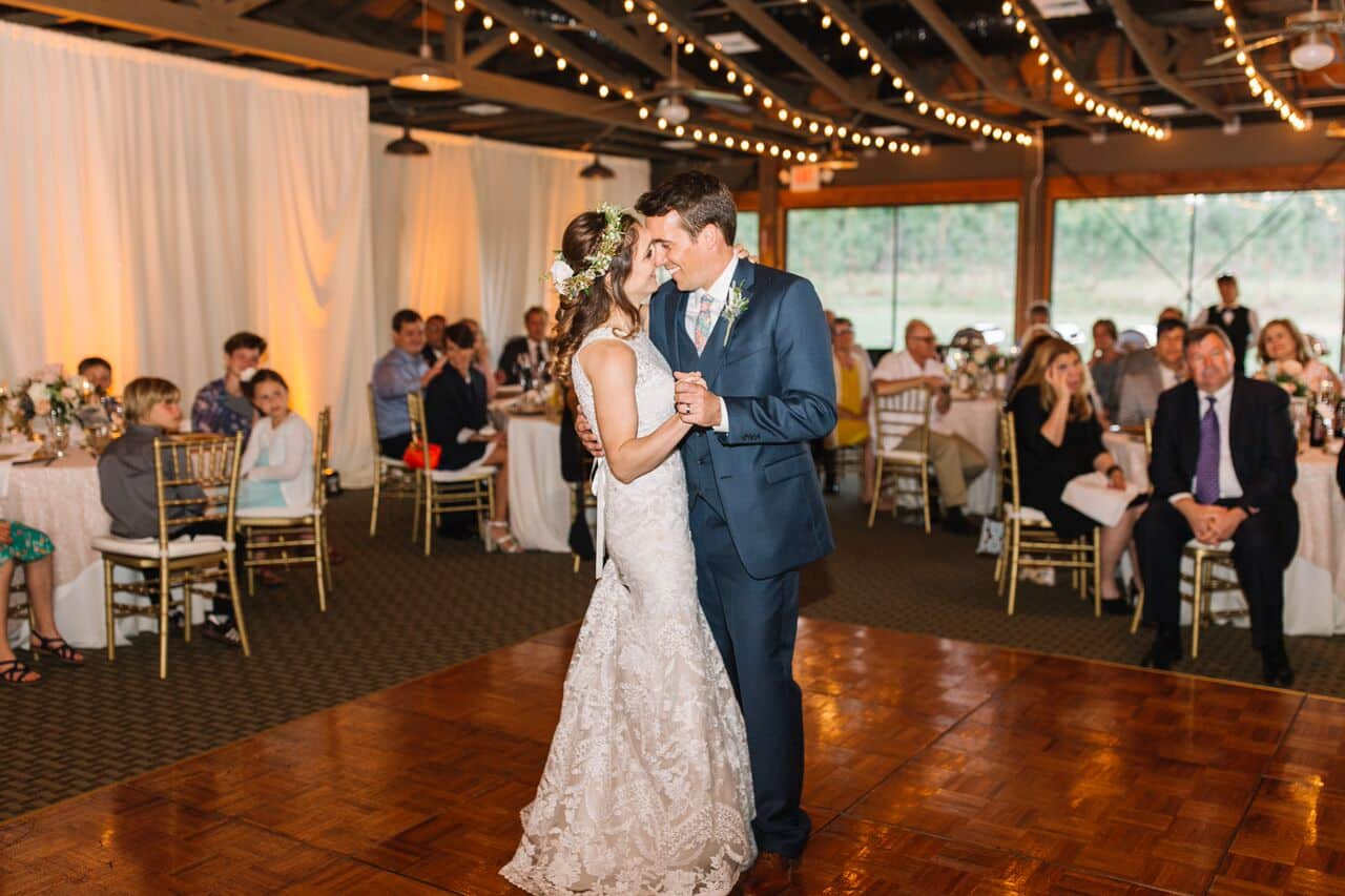 mission inn wedding with amber uplighting couple first dance
