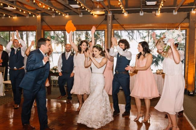 mission inn wedding with amber uplighting bride and groom dancing