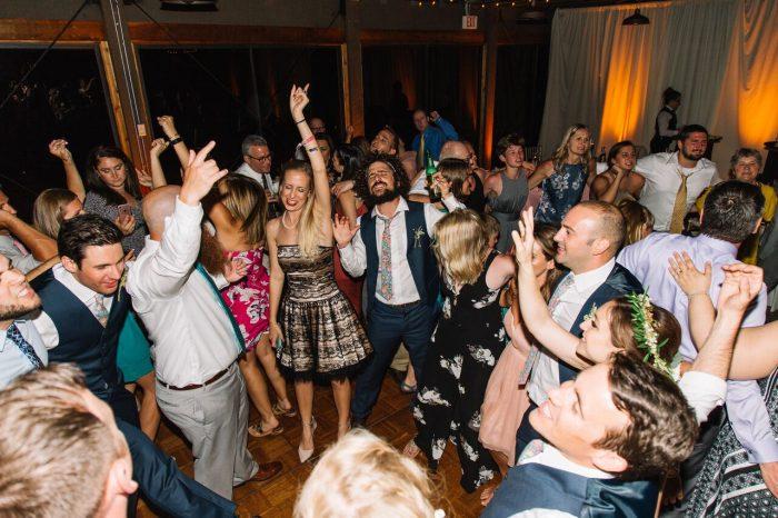 mission inn wedding with amber uplighting reception dancing