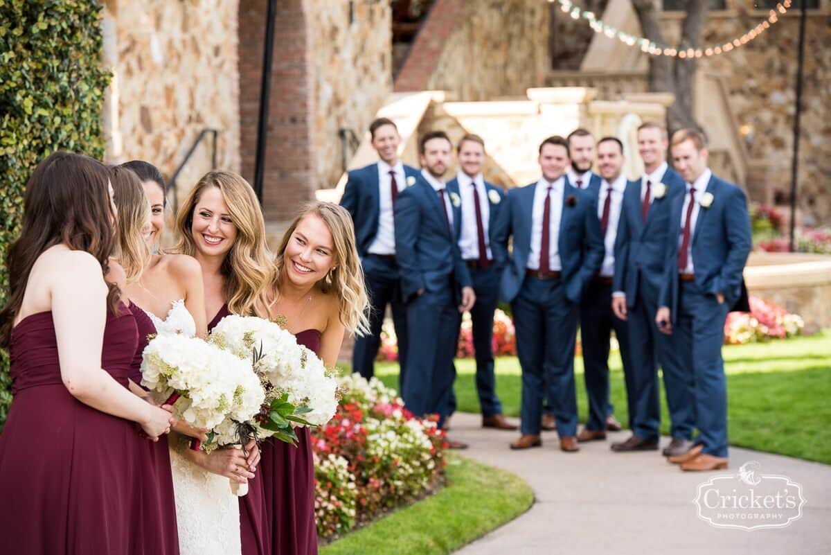 vendors who rock Crickets photography groomsmen looking at bride and bridesmaids