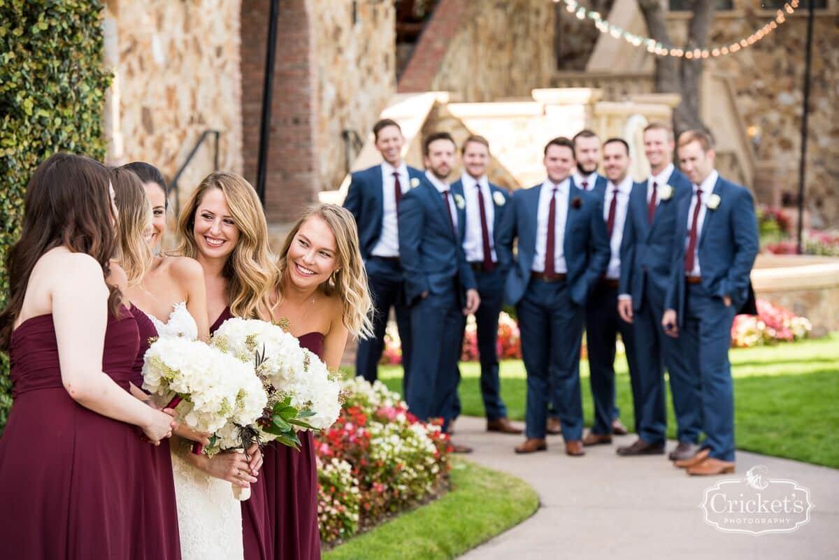 vendors who rock Crickets photography groomsmen looking at bride and bridesmaids