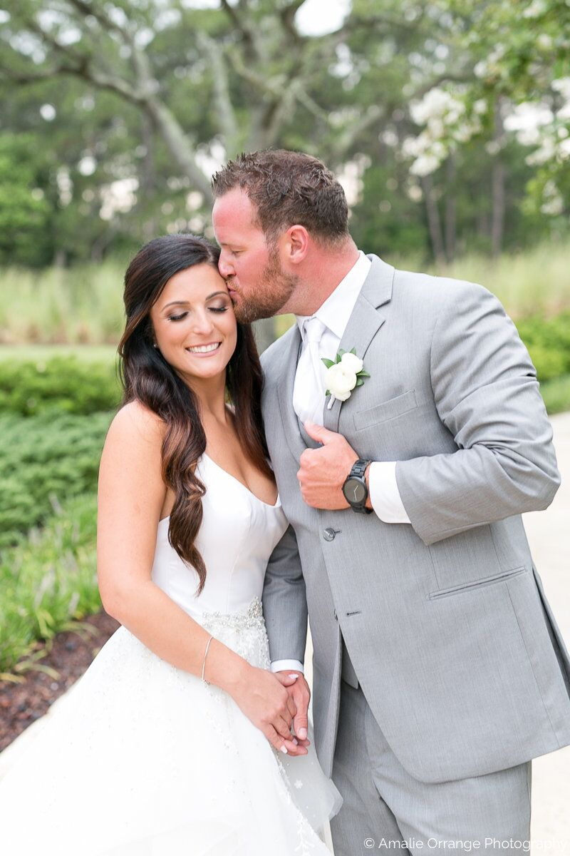 Wedding DJ in Orlando at Four Seasons Resort bride and groom forehead kiss