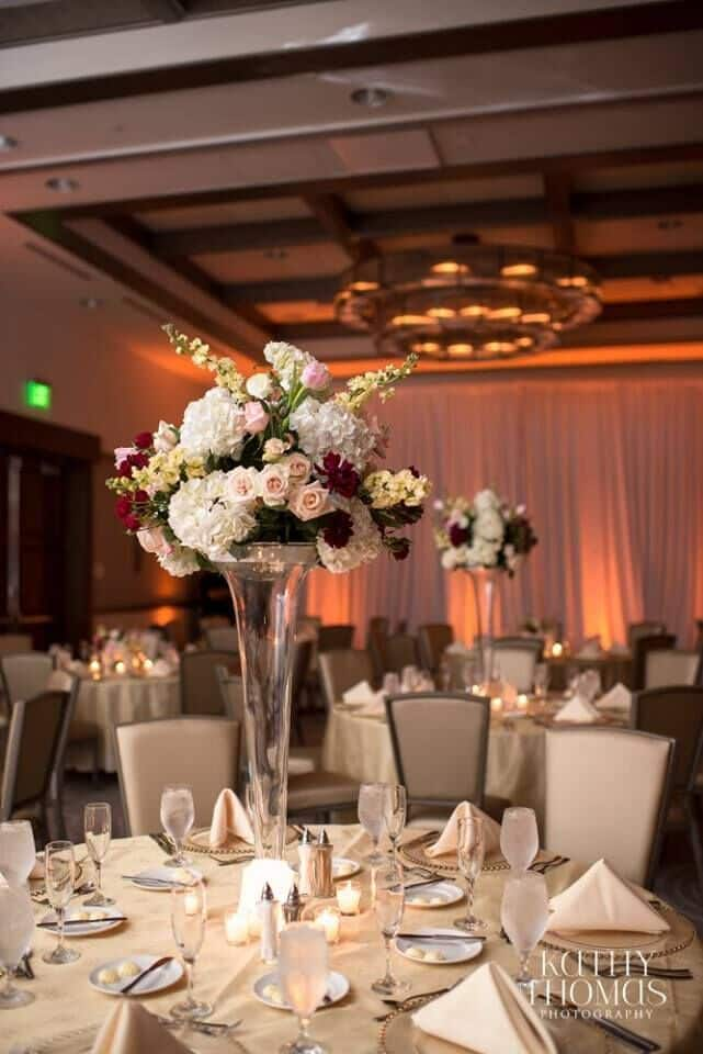 dancing on a cloud at Alfond Inn wedding table flowers and decor with amber uplighting