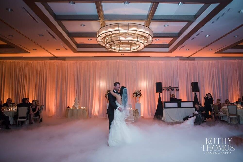 dancing on a cloud at Alfond Inn wedding with amber uplighting and Our DJ Rocks