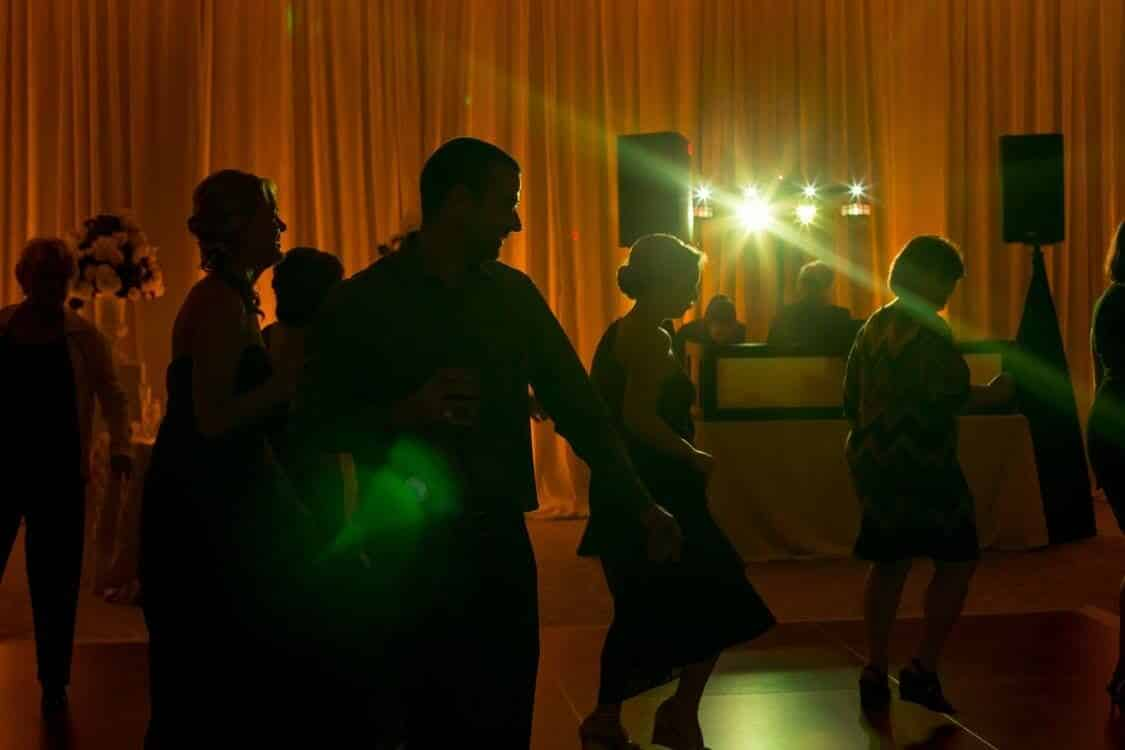 dancing on a cloud at Alfond Inn wedding reception dancing with amber uplighting and Our DJ Rocks