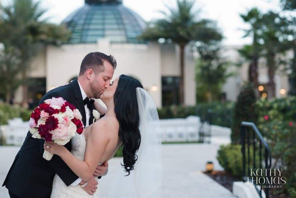 dancing on a cloud at Alfond Inn wedding bride and groom kissing