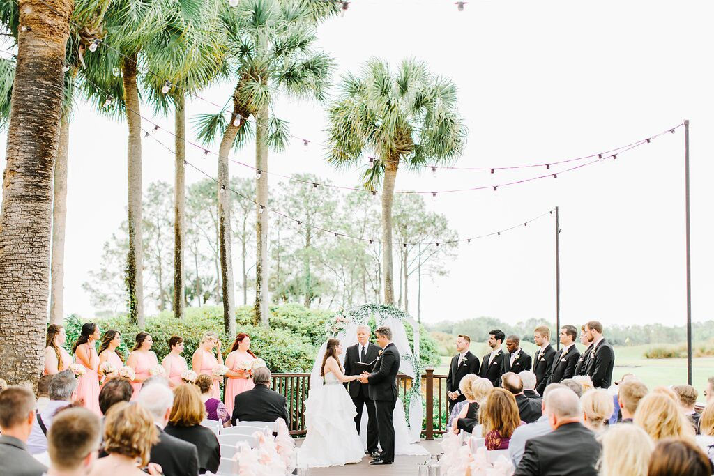 Villas of Grand Cypress Wedding ceremony with blush pink uplighting