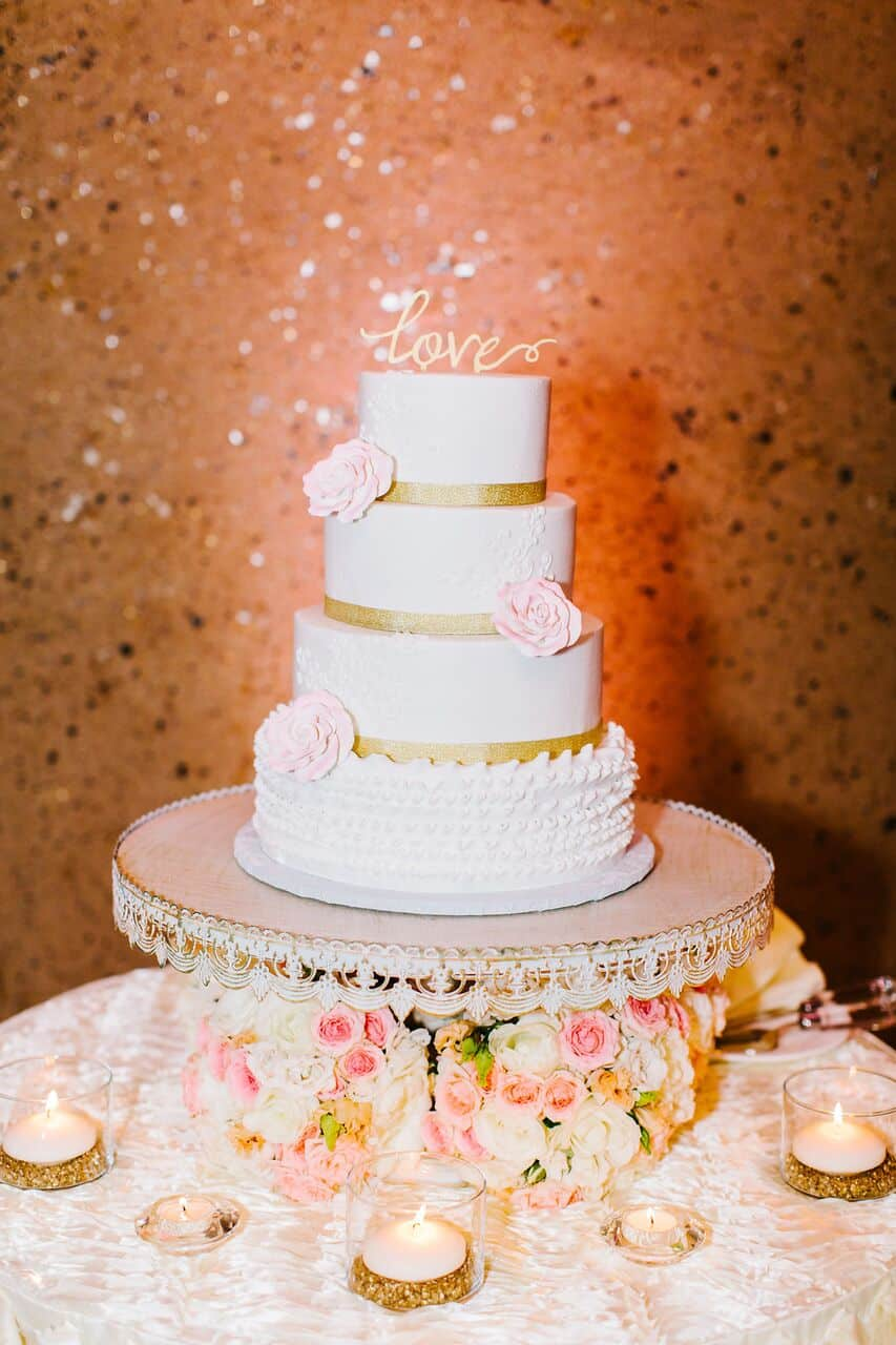 Villas of Grand Cypress Wedding with blush pink uplighting wedding cake