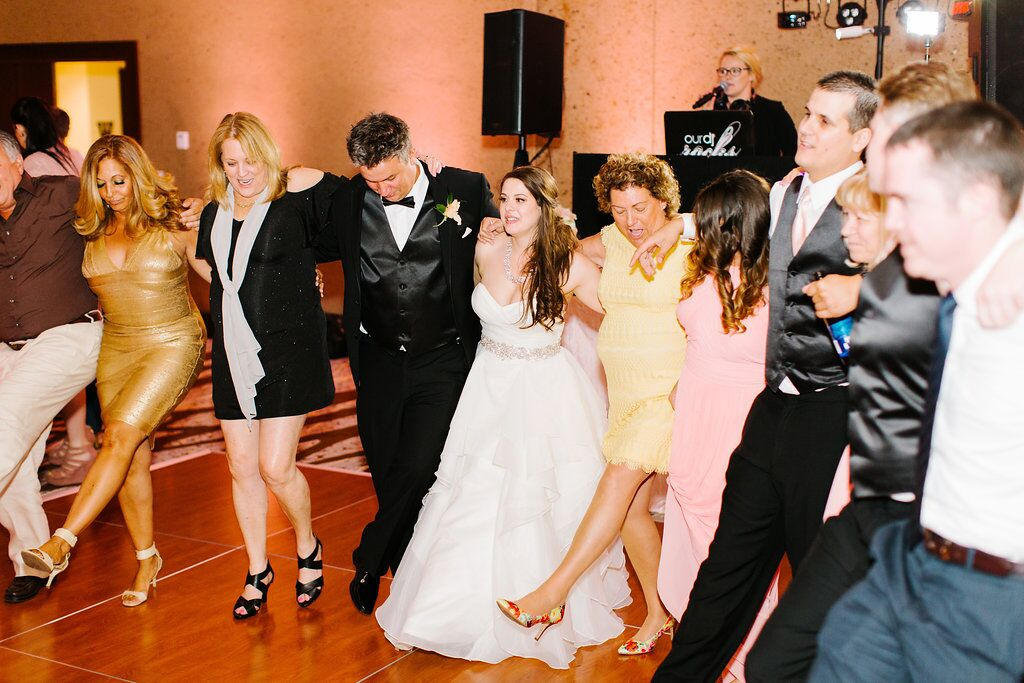 Villas of Grand Cypress Wedding reception dancing with blush pink uplighting
