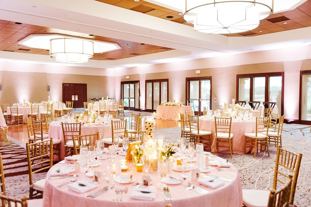 Villas of Grand Cypress Wedding reception area with blush pink uplighting