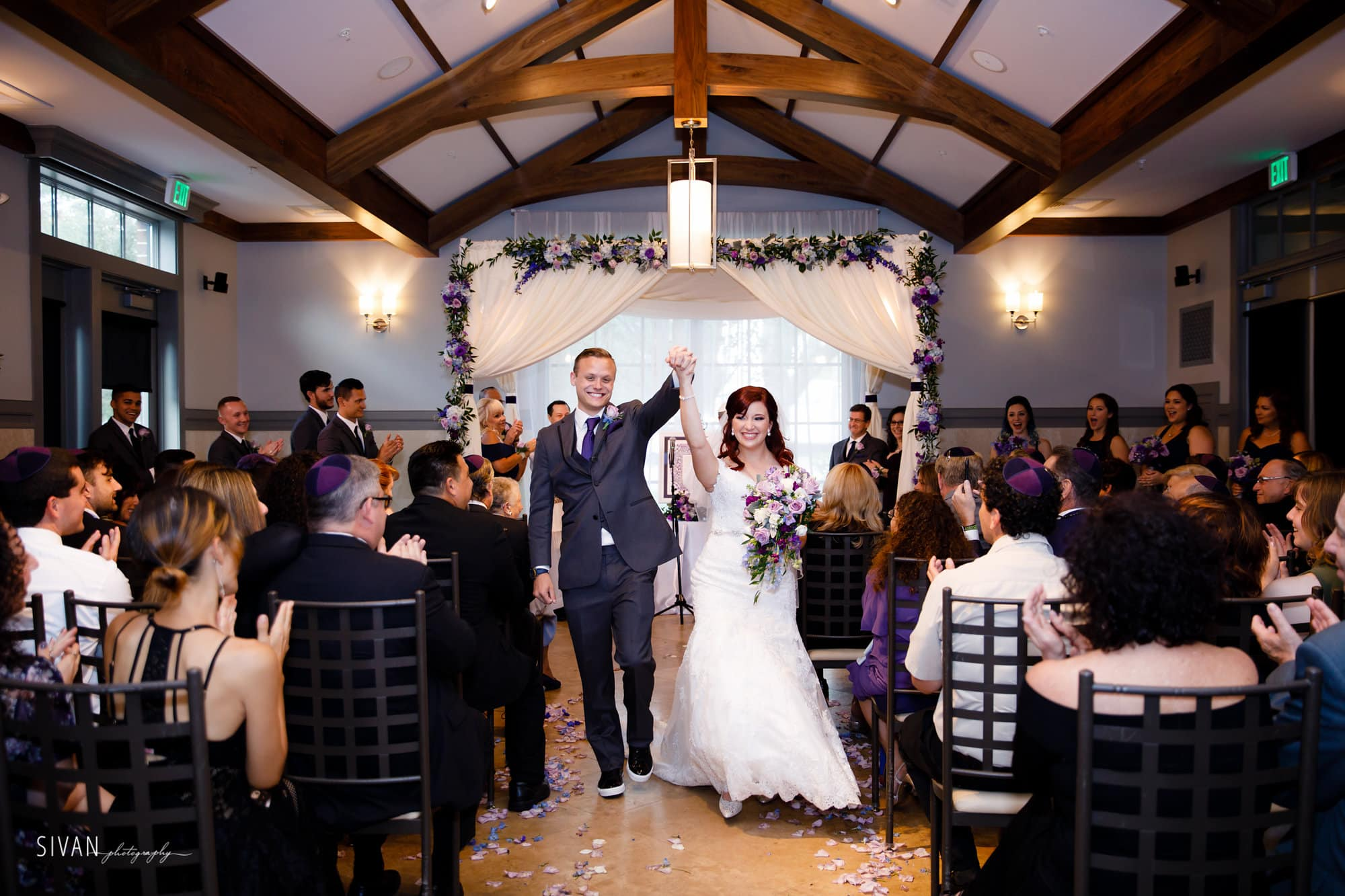 80+ Wedding Entrance Songs to start your reception off with a bang!