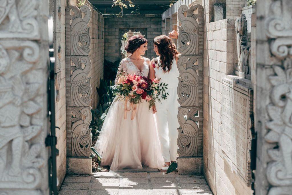 brides walking down stone walkway