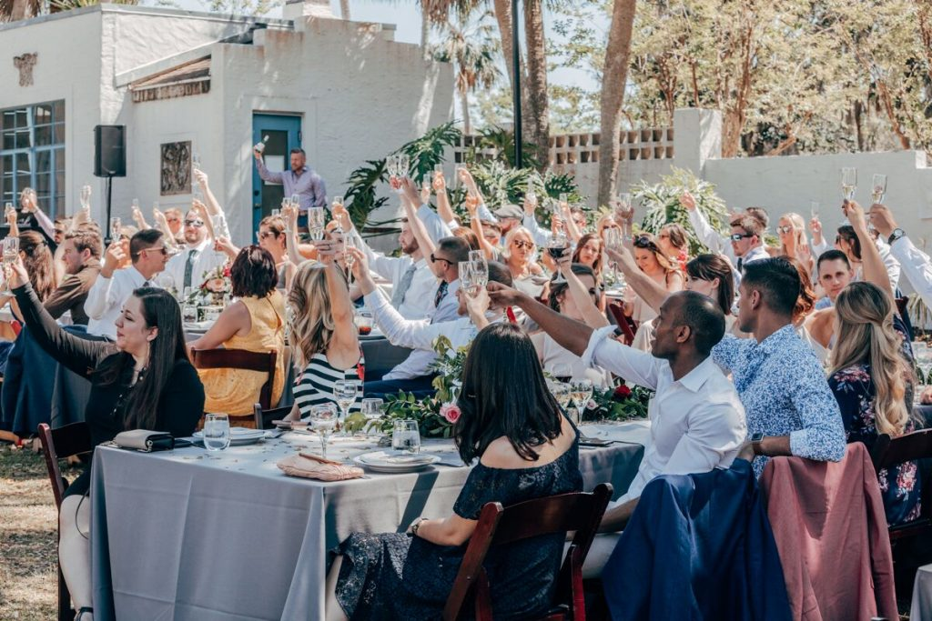 wedding guests raising glasses for a toast