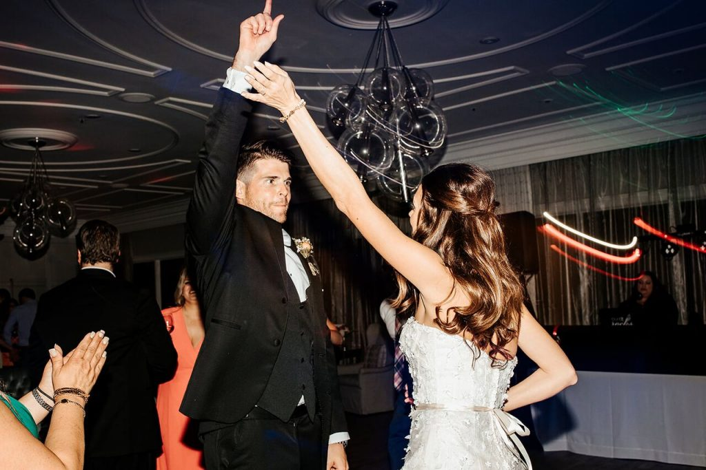 bride and groom rocking out