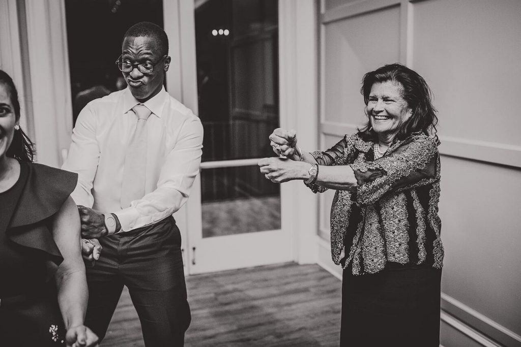 black and white of guests dancing