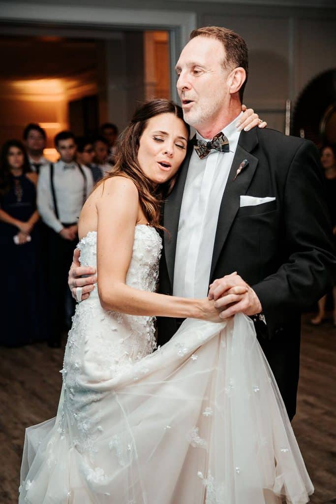 bride and father singing and slow dancing