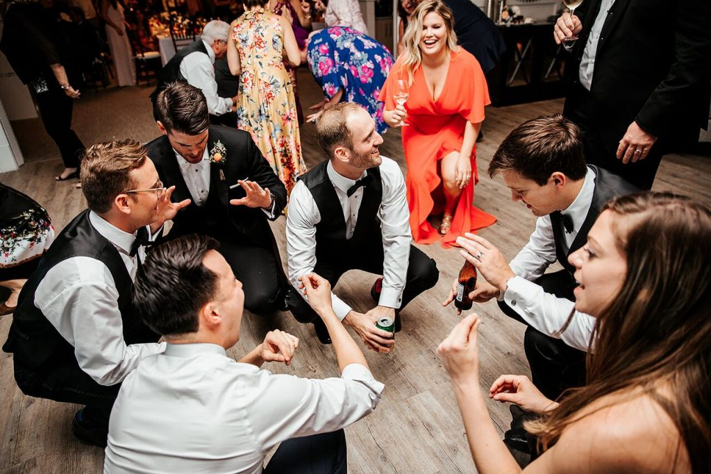 wedding guests getting low on the dance floor