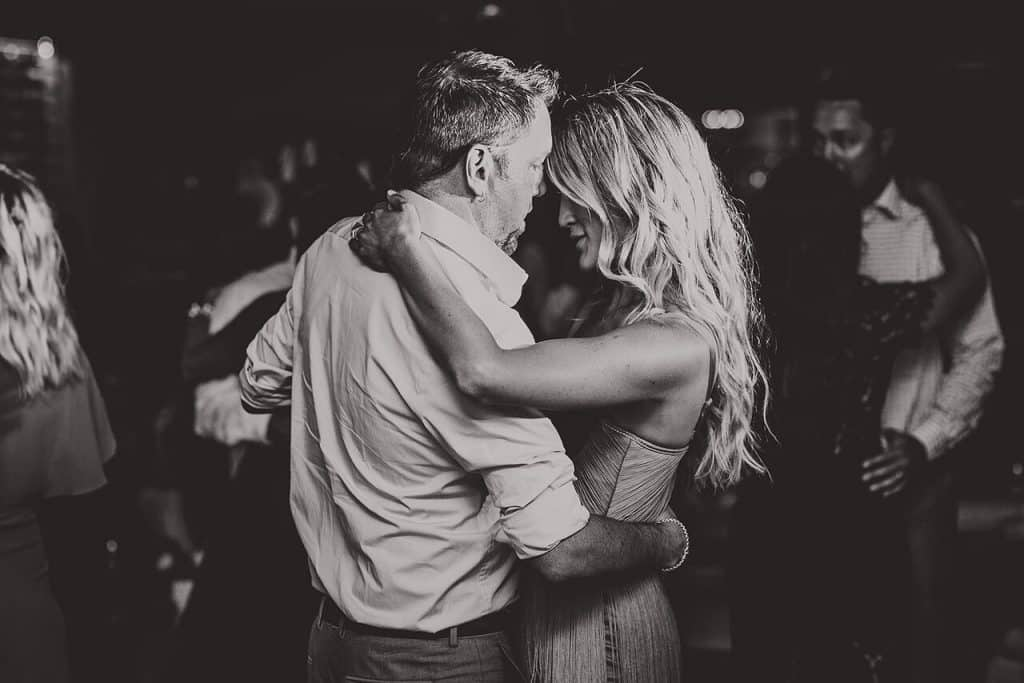 black and white slow dancing couple