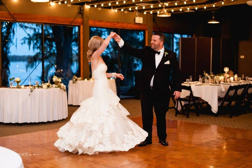 groom spinning bride on dance floor