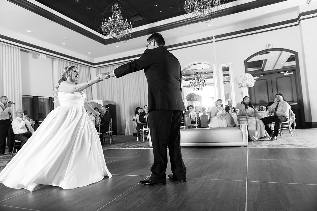 black and white bride and groom on wyndham bonnet creek dance floor