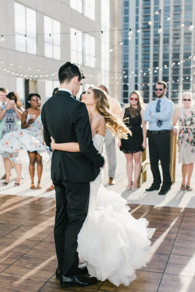 Tim + Brittany sharing first dance on rooftop venue