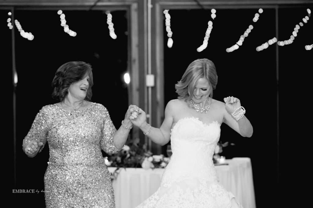 black and white photo of mother and bride dancing