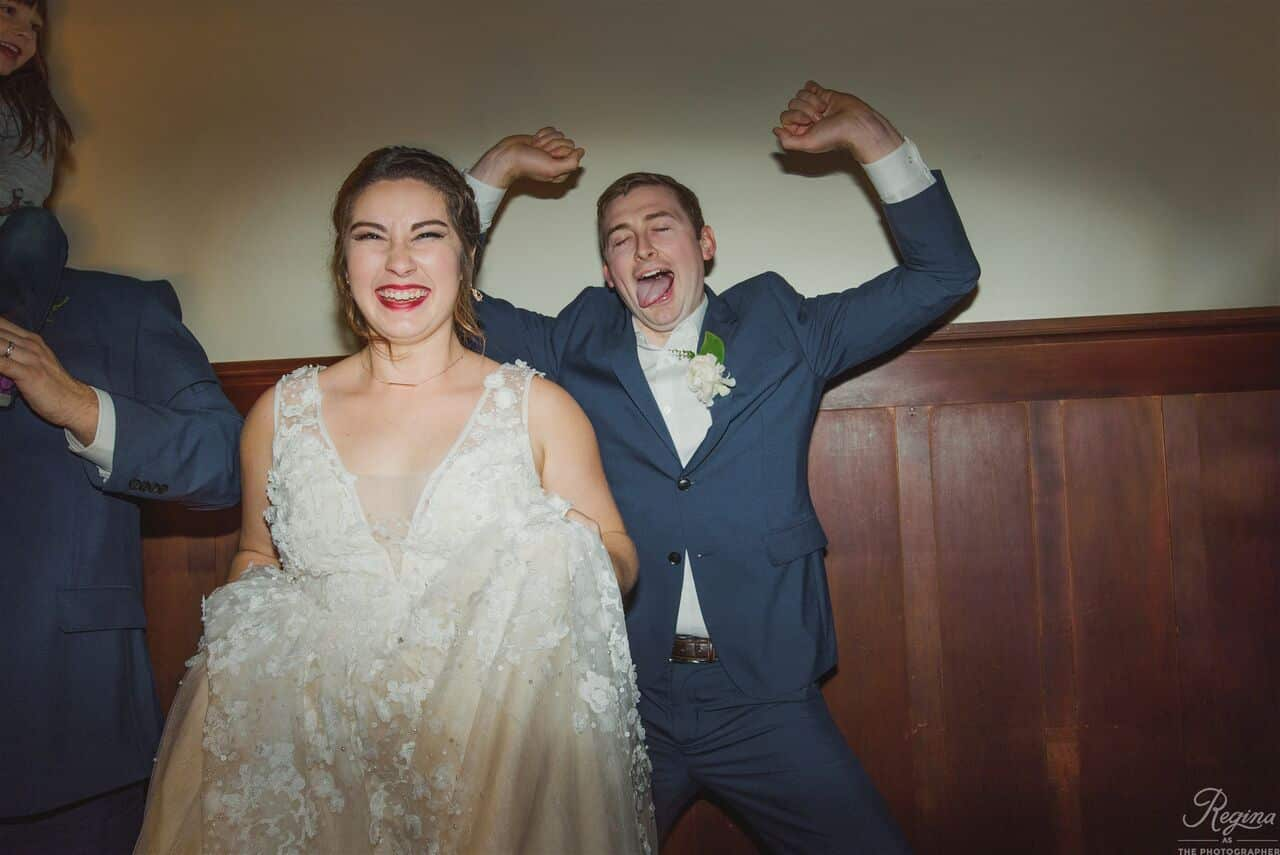 bride and groom acting silly