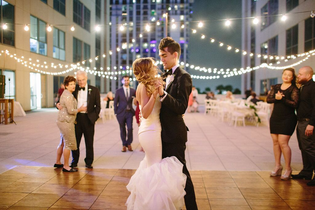 Tim + Brittany sharing intimate dance on beautiful rooftop venue