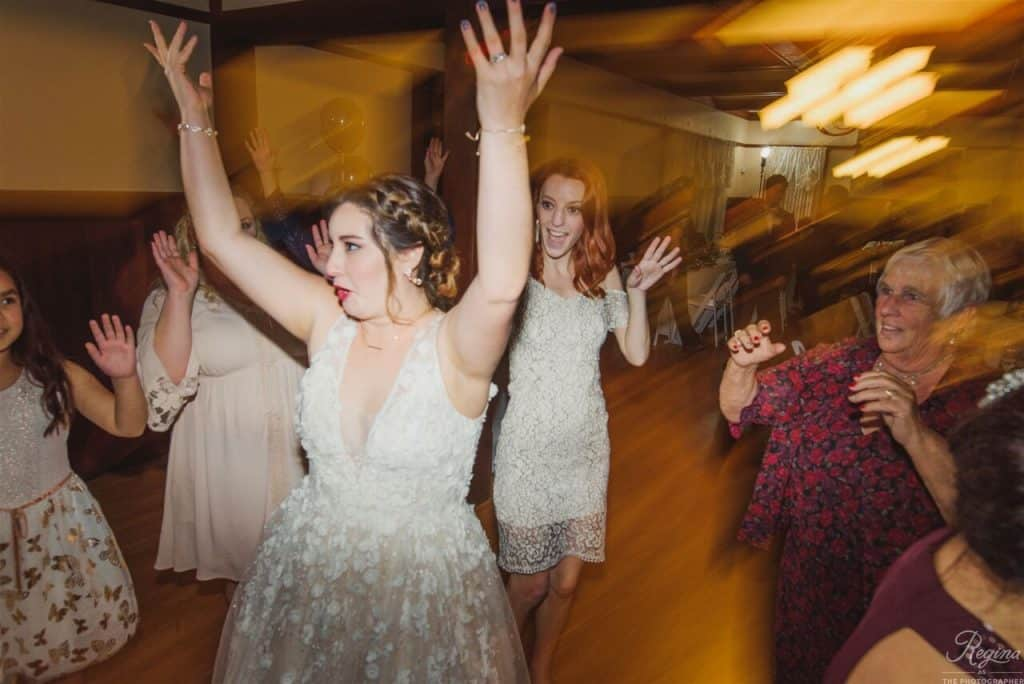 bride and guests dancing the night away