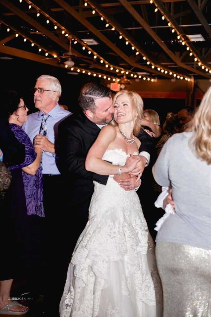 bride and groom sharing fun intimate moment on dance floor