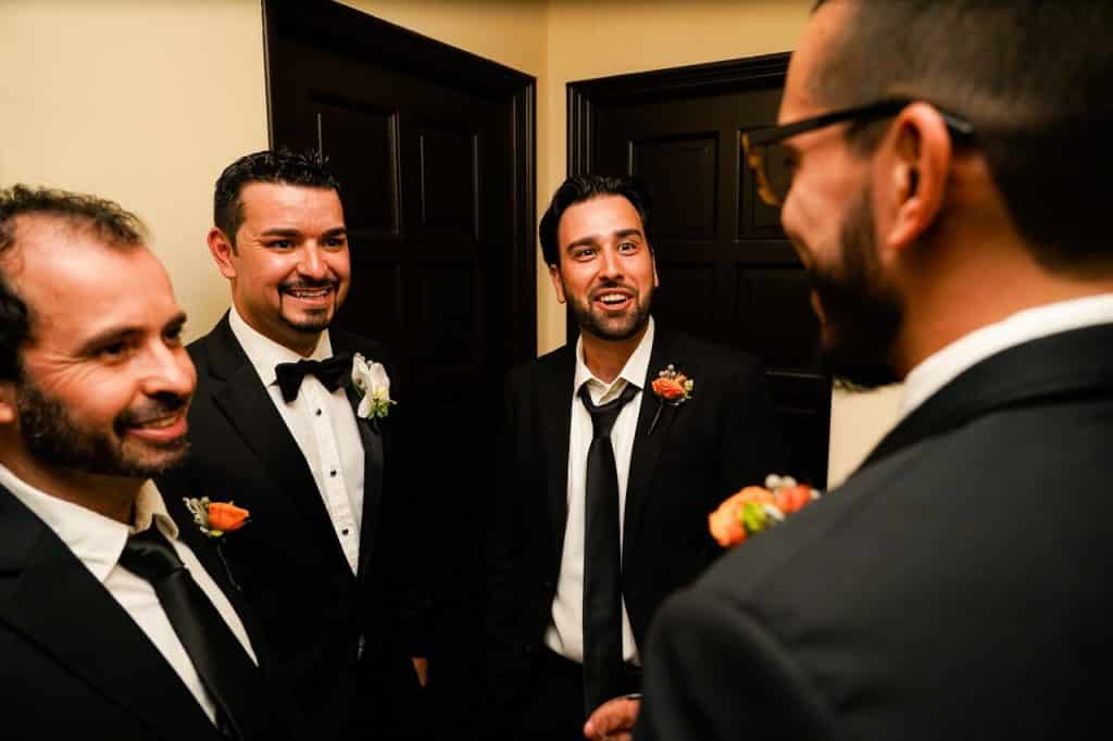 groom and groomsmen in hallway