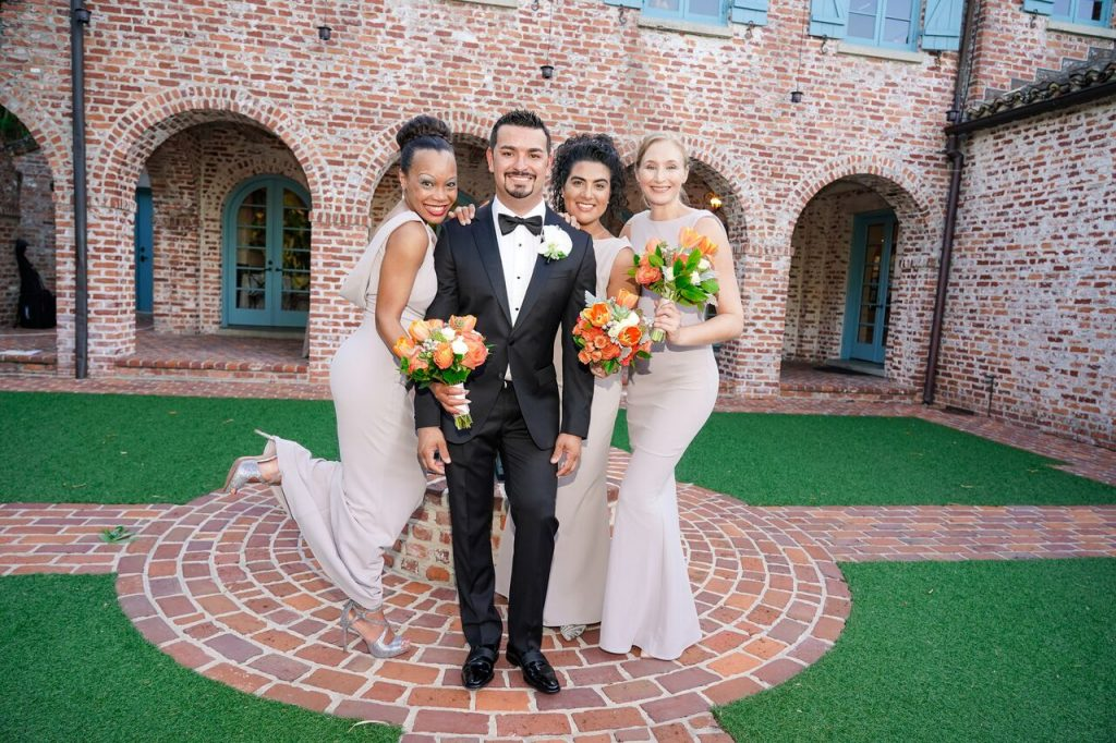 groom with bridesmaids in Casa Feliz courtyard
