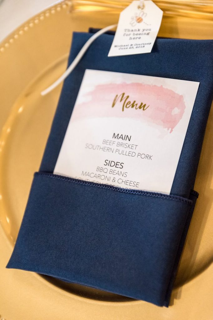 Wedding menu tucked into napkin