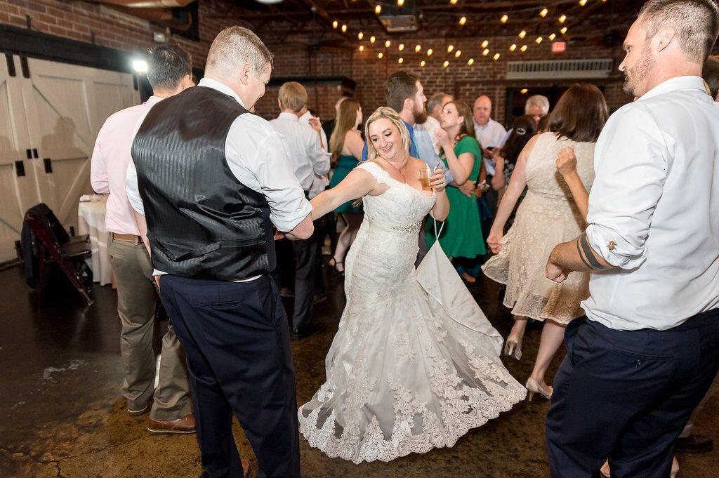 bride and groom having a drink on dance floor