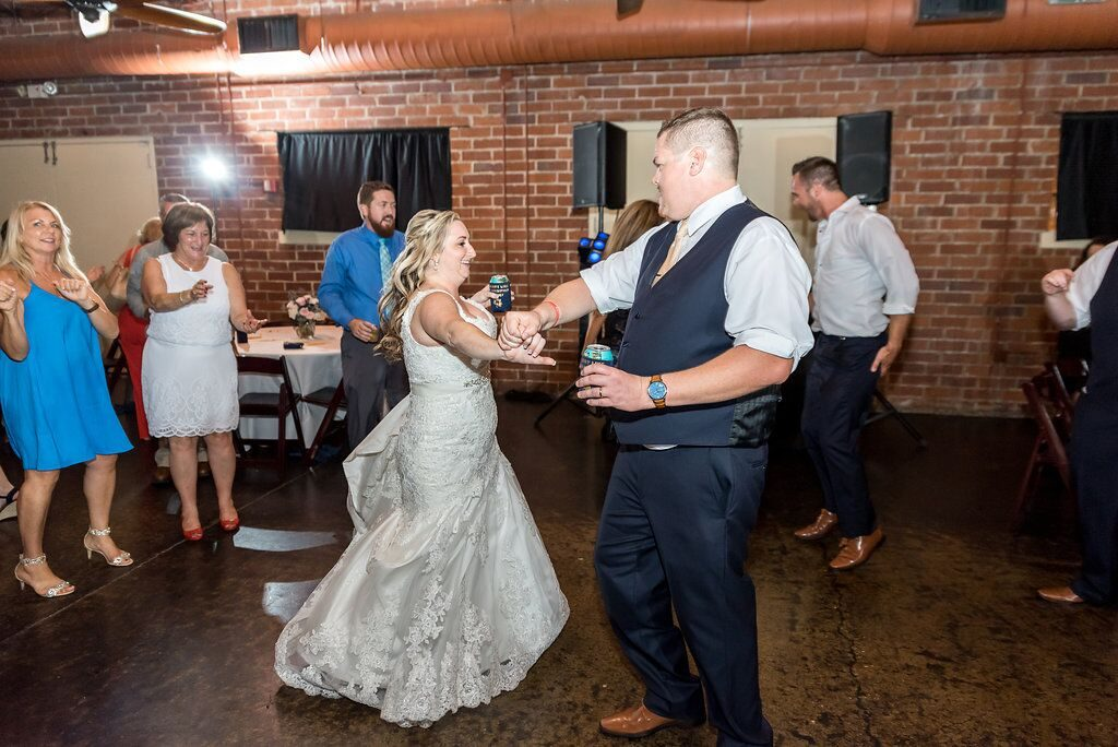 bride and groom dancing and drinking beer